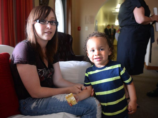 Kachina Baker of Green Bay with 2-year-old son, Easton, at House of Hope, Tuesday, July 22, 2014.