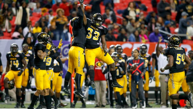 Grambling State Tigers defensive back Jameel Jackson (33) celebrates with teammates after an interception against the North Carolina Central Eagles in the fourth quarter at the Georgia Dome. The Tigers won 10-9.