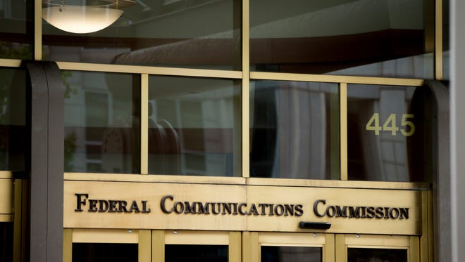 """This June 19, 2015, file photo, shows the Federal Communications Commission building in Washington. Trumpism is slowly taking hold on your phone and computer, as the FCC starts rolling back Obama-era measures, known as """"net neutrality"""" rules, which were designed to keep phone and cable giants from favoring their own internet services and apps. President Donald Trump's hand-picked FCC chief, Ajit Pai, wants to cut regulations that he believes are holding back faster, cheaper internet."""