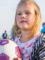Hundreds attended the Kohl's American Cup soccer tournament in Altoona. Seventy-eight teams from around Iowa competed. Kristiana Wakely, 3, attended to watch her brother play, but wanted to join in on the fun.