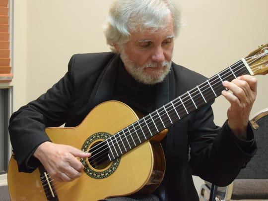 Classical guitarist John De Chiaro plays the ragtime