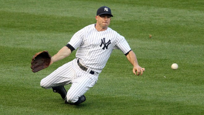 Yankees left fielder Brett Gardner cannot make a catch on a single by the Mariners' Dustin Ackley during the second inning at Yankee Stadium.