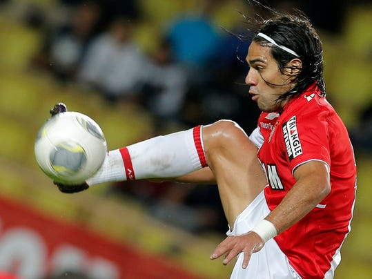 FILE - This is a Friday, Nov. 8, 2013 file photo of Monaco's  Radamel Falcao of Colombia as he controls the ball during his French League One soccer match against Evian, in Monaco stadium.   Radamel Falcao is set to join Manchester United on loan after the Premier League club agreed to a loan deal with Monaco, a person with knowledge of the deal said Monday Sept. 1, 2014. (AP Photo/Lionel Cironneau, File)