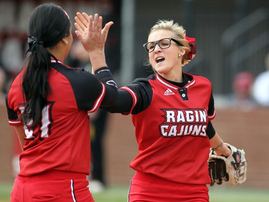 Leslie Westbrook/The Advertiser UL pitcher Christina Hamilton high-fives third baseman Samantha Walsh during a tournament win earlier this season. The No. 5-ranked Ragin' Cajuns will be traveling to meet No. 4 Alabama on Saturday and Sunday. UL pitcher Christina Hamilton high fives third baseman Samantha Walsh after a successful inning against Iowa in an NCAA softball game Friday, February 20, 2015, at Lamson Park in Lafayette, La.