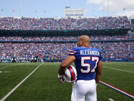 Bills captain Lorenzo Alexander stands off to the side