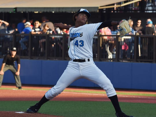 Renegades' Jhonleider Salinas winds up a pitch during a past home opener at Dutchess Stadium in Fishkill. Baseball is a summertime classic.