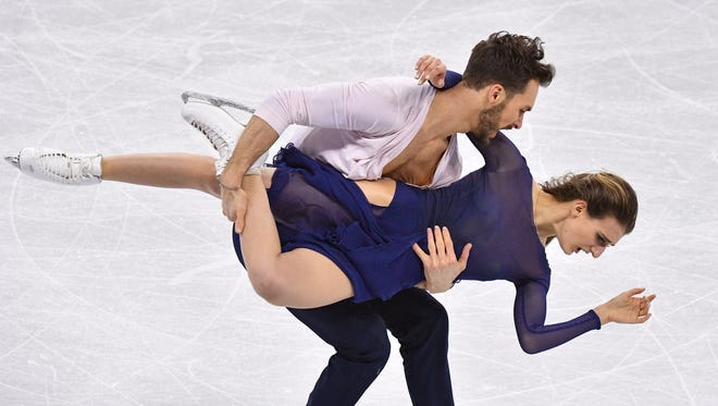 Gabriella Papadakis and Guillaume Cizeron (FRA) perform in the ice dancing.