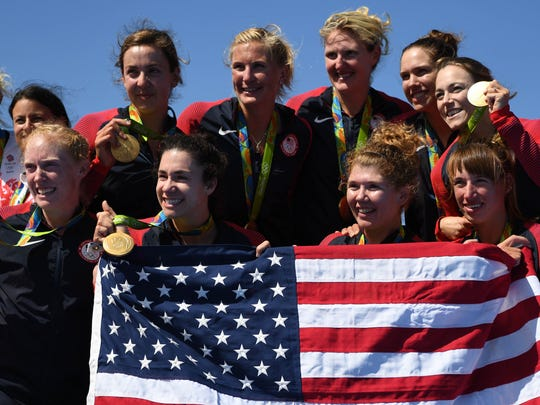 Team USA celebrates winning gold medals after women's eight rowing competition in the Rio 2016 Summer Olympic Games at Lagoa Stadium.