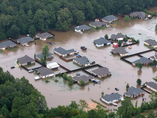 Flooded homes along the Tangipahoa River near Amite, La.,  Saturday, Aug. 13, 2016.