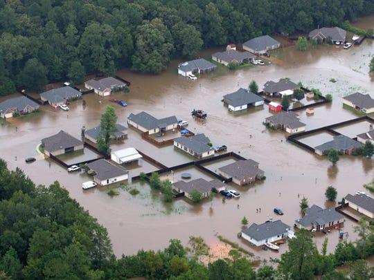 Flooded homes along the Tangipahoa River near Amite,
