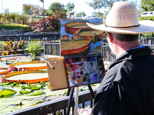 Artists paint during EnPleinAir TEXAS Tuesday, Oct. 24, 2017, at International Waterlily Collection in Civic League Park.
