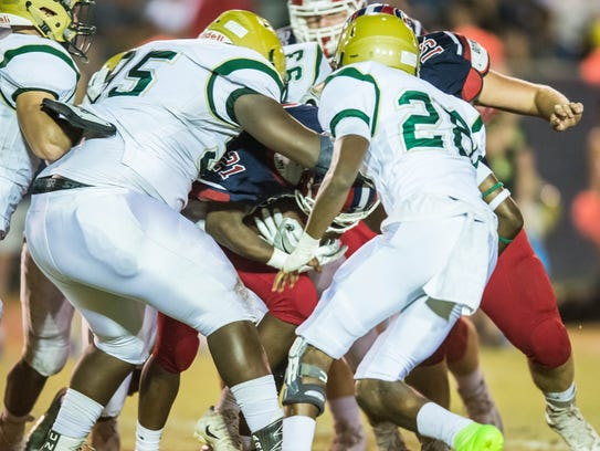 Acadiana High defensive tackle Elisha Sion (95) contributed 14 tackles behind the line of scrimmage for the Wreckin' Rams so far this season.