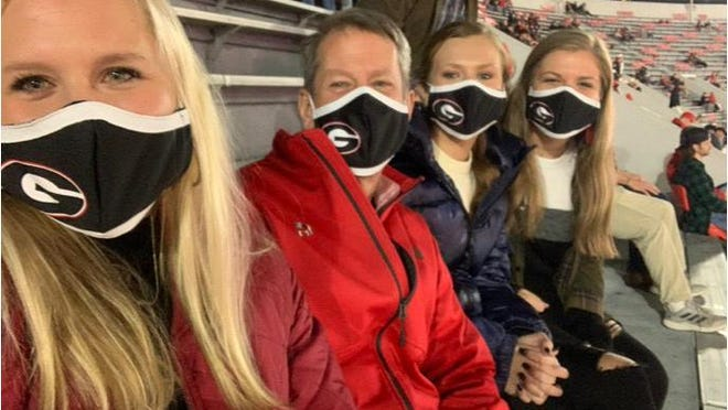 Georgia governor Brian Kemp attends Saturday's Georgia game against Mississippi State with his three daughters.