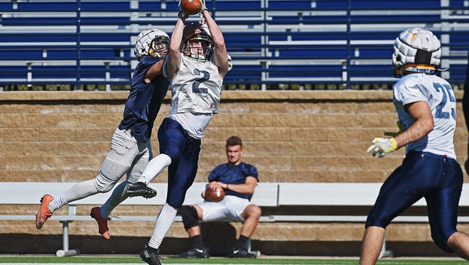Augustana's Alek Keegan (2) participates in a drill during a spring football practice Friday, April 7, 2017, at Kirkeby–Over Stadium on the Augustana University campus.