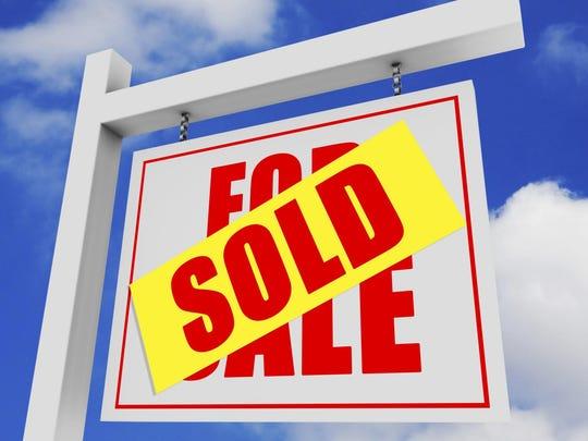SoldForSaleSign524265805.jpg