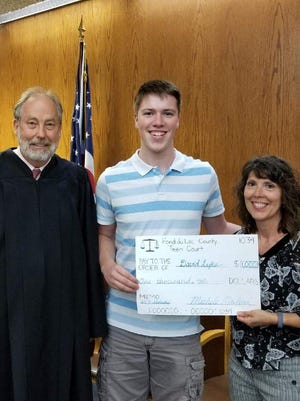 Circuit Court Judge Gary Sharpe and Teen Court coordinator, Michele Mailand, presented David Lyke with a $1000 scholarship.