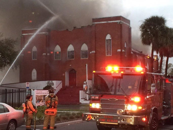 Heavy smoke fills the air as a Tampa church burns on
