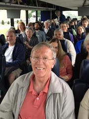 Area residents en route to climate march Saturday in Washington, D.C. In the foreground is Michael Hoffmann, executive director of the Cornell Institute for Climate Smart Solutions.