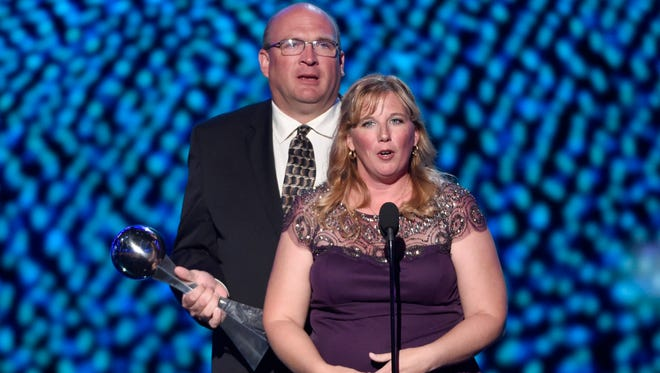 Lisa Hill, right, and Brent Hill accept the best moment award on behalf of their daughter Lauren Hill at the ESPY Awards at the Microsoft Theater on Wednesday, July 15, 2015, in Los Angeles.