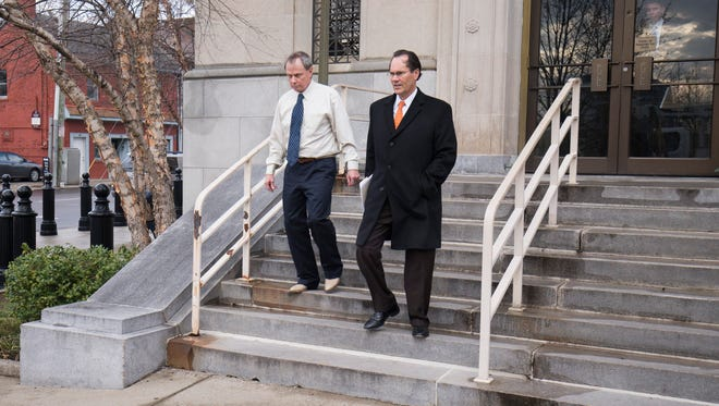 Samuel McIntosh of Lexington, Ky exits the federal court building with his attorney James Lowry after a hearing related to the Timothy Longmeyer Bribery Case. McIntosh plead guilty to four counts of bribery of a public official and one count of honest services mail fraud.