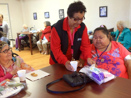 Volunteer Lupita Cantu (center), from Senior Companion Program, delivers snacks to Teresa Arispe (left) and Grace Luna on Tuesday, Jan. 24, 2017, at San Rafael Nursing and Rehabilitation Center  in Corpus Christi.