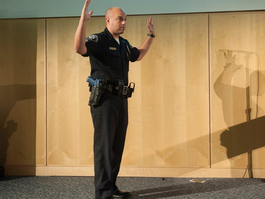 Camden County Police officer Chris Sarlo re-enacts an emergency street scene during a police training demonstration at Camden County College.  The Camden County Police Department and the Camden County College Police Academy, in conjunction with the nationally renowned Police Executive Research Forum (PERF)  hosted a scenario-driven training session on innovative policing tactics.