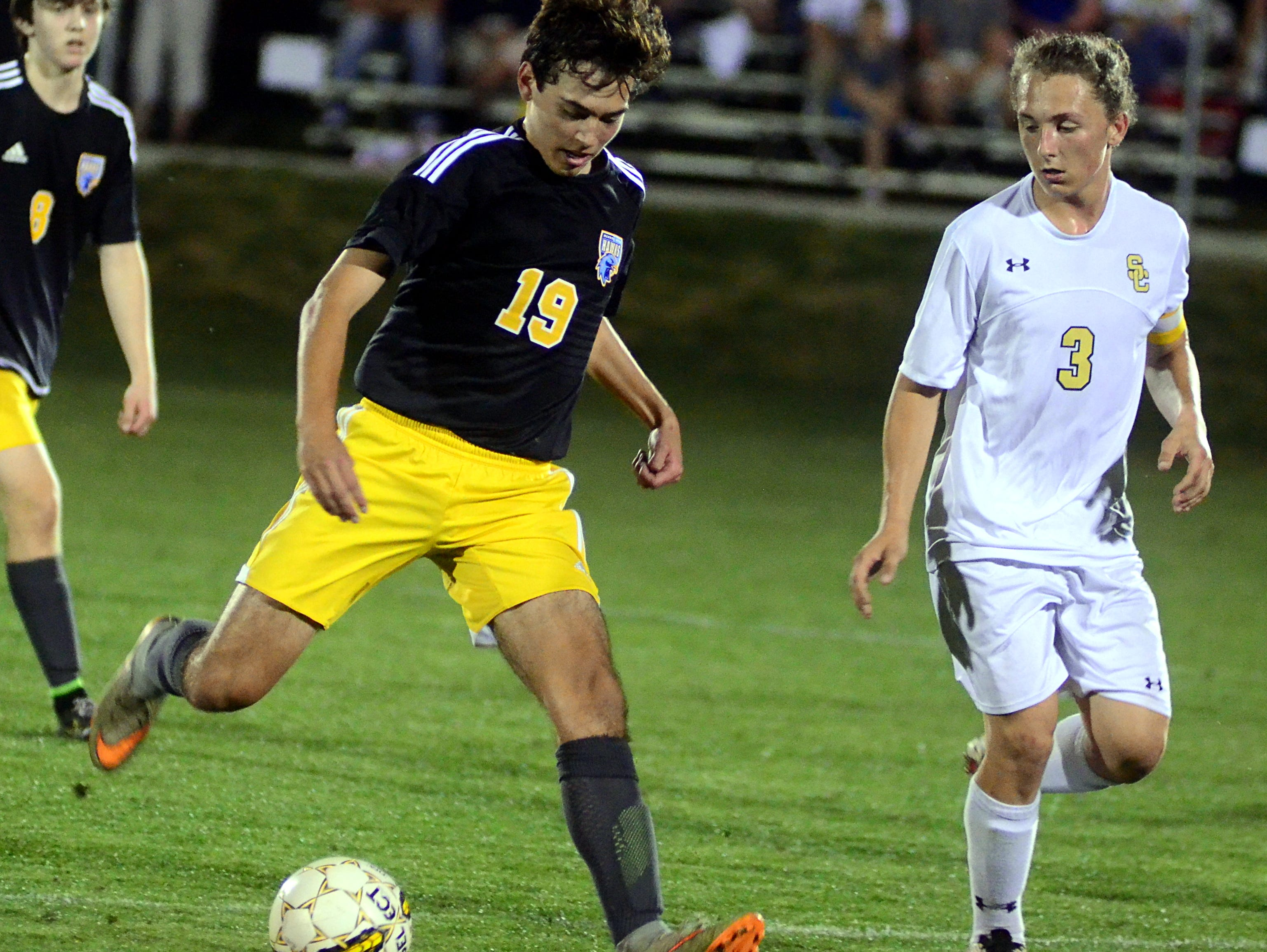 Merrol Hyde Magnet sophomore Daniel See gains possession under pressure from Smith County senior Ethan Babcock during second-half action.