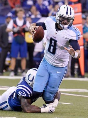 Colts inside linebacker D'Qwell Jackson (52) sacks Titans quarterback Marcus Mariota (8) in the fourth quarter Sunday.
