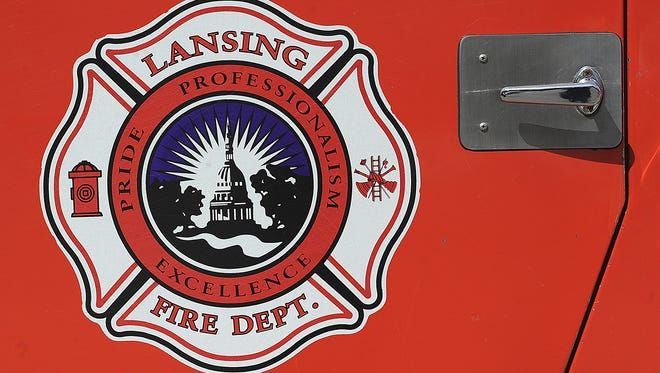 Lansing firefighters helped deliver a set of twins on Monday night in a small bathroom on the city's south side.