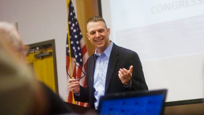 U.S Representative Scott Perry talks with constituents during a town hall meeting on Monday Feb. 17, 2014 at Hanover Hospital Wellness Education Center in Hanover.