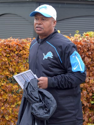Detroit Lions coach Jim Caldwell watches practice in London.