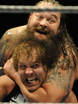 Bray Wyatt (above) and Dean Ambrose during a WWE show at Garrett Coliseum last year.