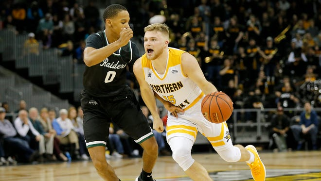 Northern Kentucky Norse guard Tyler Sharpe (15) drives against Wright State Raiders guard Jaylon Hall (0) in the second half of the NCAA basketball game between the Northern Kentucky Norse and the Wright State Raiders at BB&T Arena in Highland Heights, Ky., on Thursday, Jan. 11, 2018.