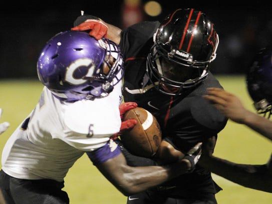 Clarksville High's D'Vaughn Whitt (6) tries to make