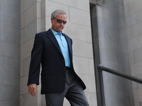 Developer Keith Vinson leaves the federal courthouse in 2013 after a hearing. On Thursday he received an 18-year prison sentence for his role in the fraud and conspiracy associated with the failed Seven Falls development.