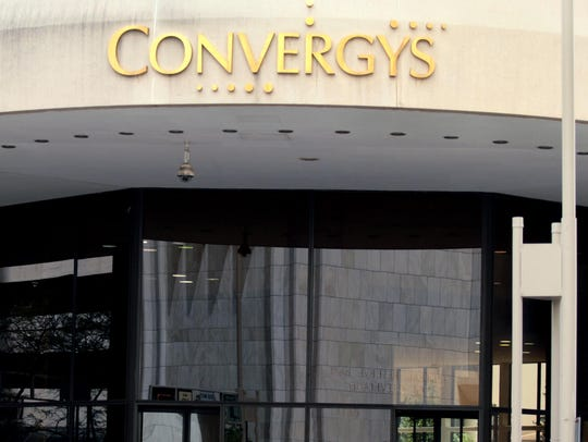 In 2010, people walk into 201 E. 4th St., Cincinnati when the curved front of the building still displayed the Convergys name. The front of the building carries another company's name now. The Cincinnati office remains in the same location, but an Erlanger, Kentucky center that employs 175 people will close Sept. 30, 2019.