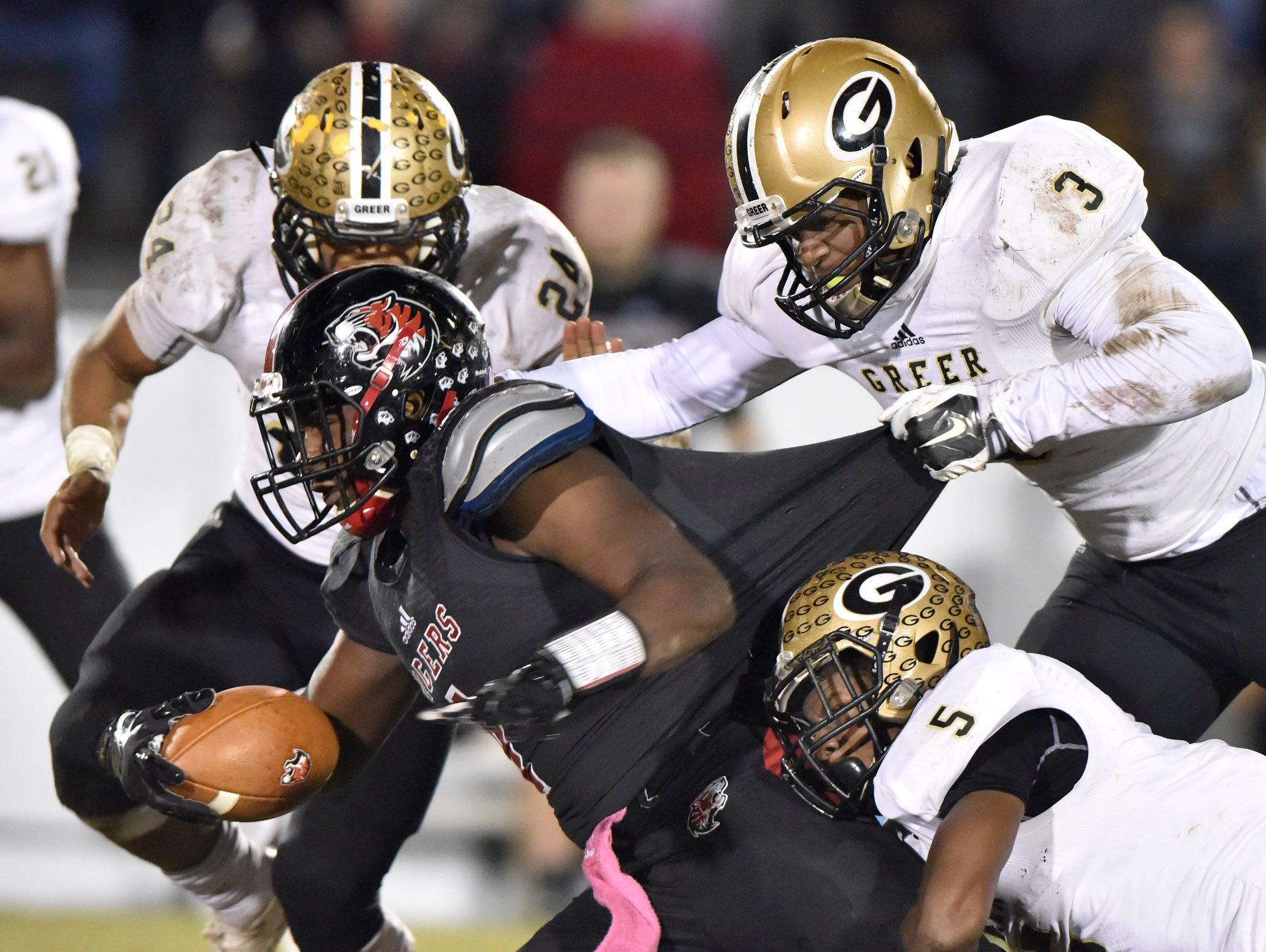 Blue Ridge's Vonta Jenkins (1) is caught by Greer's Quantavious Cohen (3), Troy Pride (5), and Adrian McGee (24).