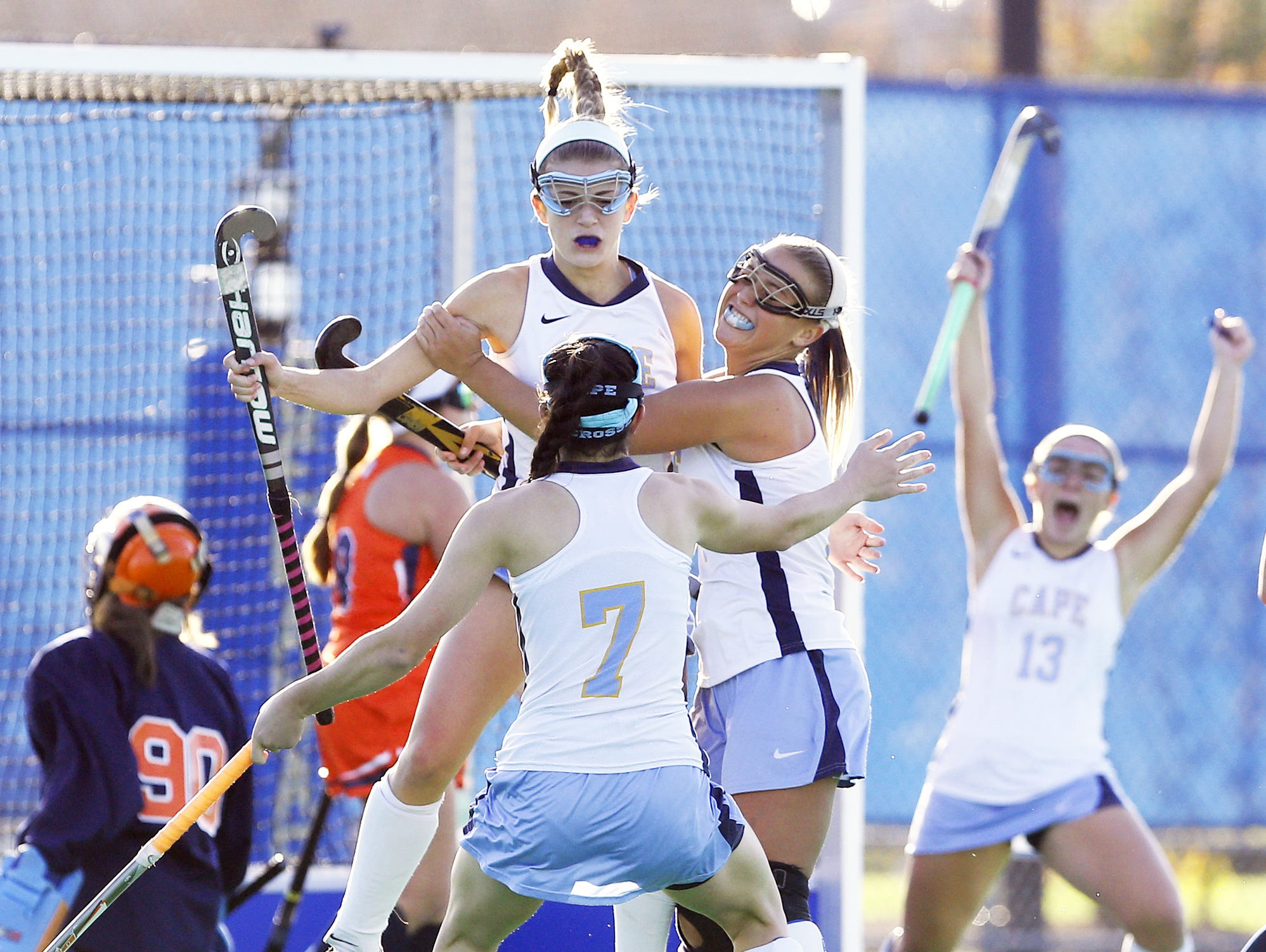 Cape Henlopen's Alia Marshall (top) celebrates her go-ahead score with Tess Bernheimer (7), Sydney Ostroski and Catherine Frederick (13) in the second half of Cape's 3-1 win in the DIAA state title game Saturday at Rullo Stadium.