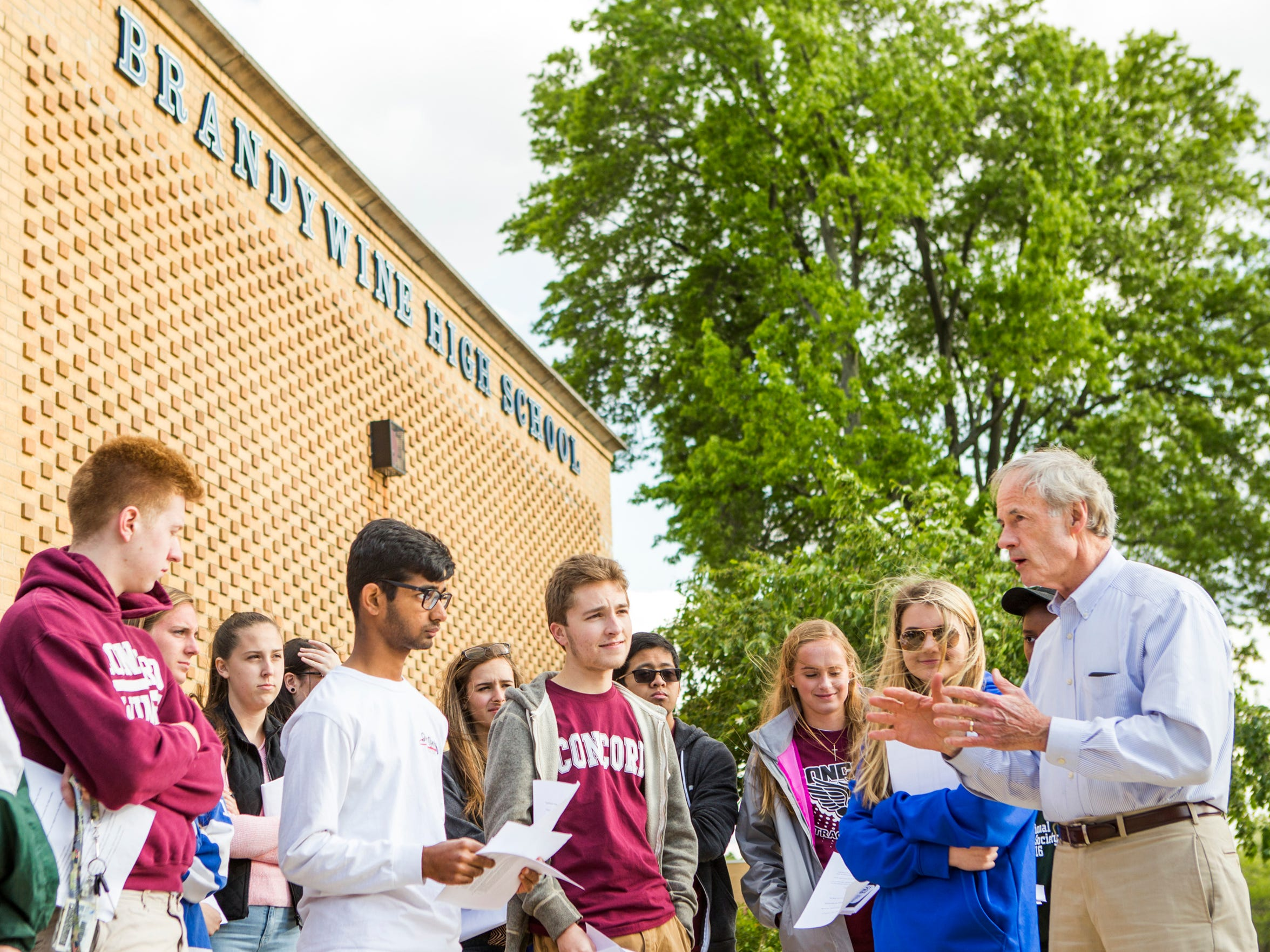 U.S. Sen. Tom Carper speaks to students outside Brandywine High School before they leave to canvass the area in support of a referendum on the Brandywine School District on Sunday afternoon.