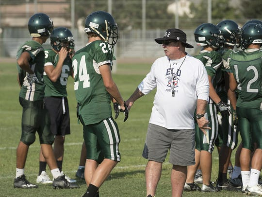 El Diamante football coach Mark Rogers talks with Mason Garispe during a practice in 2016.