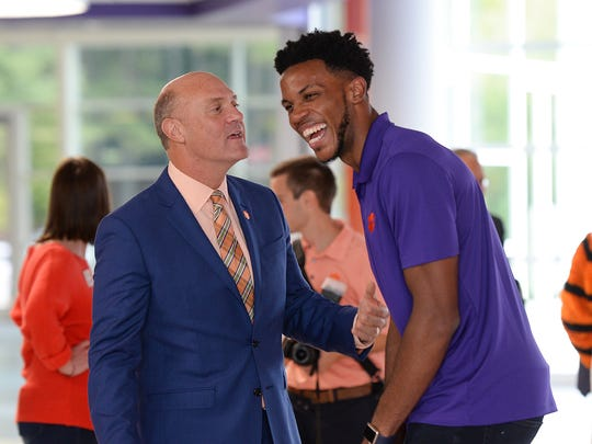 Clemson James P. Clements laughs with Clemson basketball player Jaron Blossomgame during the ribbon cutting of Clemson's newly renovated Littlejohn Coliseum on Friday, October 14, 2016.