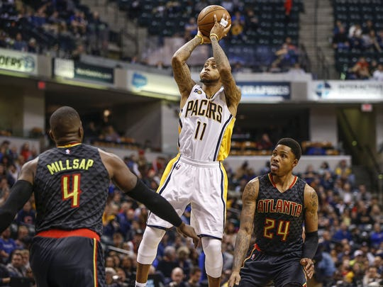 Indiana Pacers guard Monta Ellis (11) goes up for the shot over Atlanta Hawks forward Paul Millsap (4) in the second half at Bankers Life Fieldhouse on Wednesday, Nov. 20, 2016.
