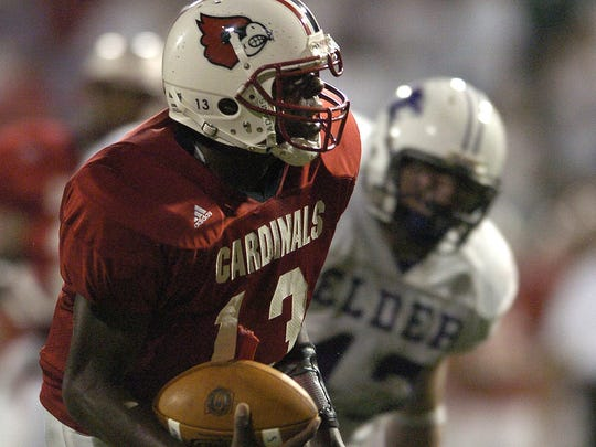 Colerain quarterback Dominick Goodman runs the ball in for a touchdown against Elder during the 2004 championship season.