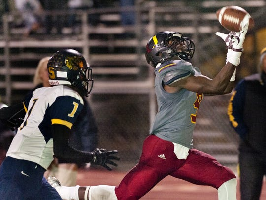 Tulare Union's Emoryie Edwards hauls in a touchdown