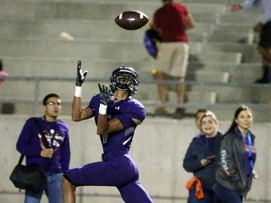 Eastlake wide receiver Emilio Rios catches a perfectly thrown pass for a touchdown against Chapin Friday night at the Socorro Activities Complex.