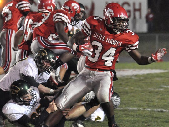 City High tailback Ronald Thompson, right, tries to