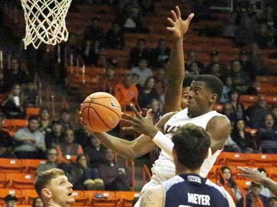 UTEP freshman Trey Wade flies to the basket for a layup against Rice Saturday night.
