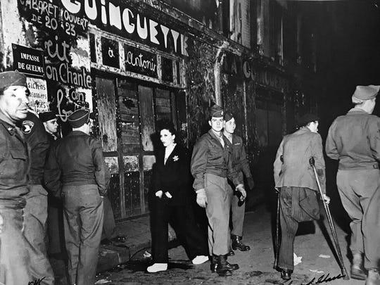 """Ed Clark, """"Paris Vets Outside Cabaret,"""" 1945, photograph, 11x14."""""""