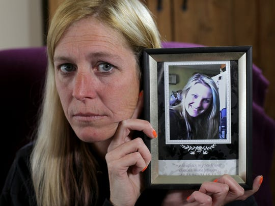 Vicky Fible holds her favorite photo of daughter Chelsea Johnson. Chelsea was stabbed and killed and her body found in Fairfield two years ago. No arrests have been made.