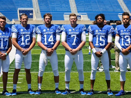 Kentucky's quarterbacks from left to right are Walker
